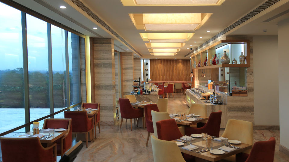 Restaurant at efcee sarovar portico hotels in bhavnagar