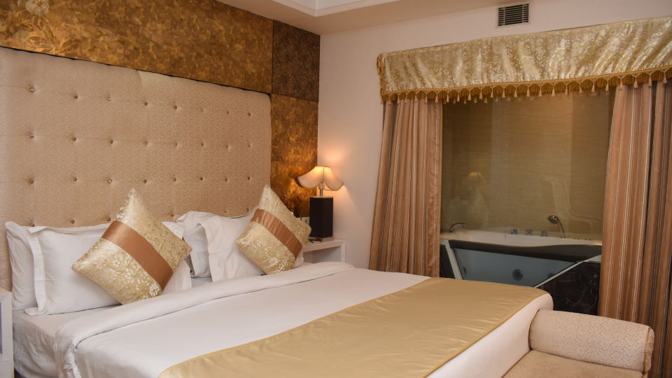King Size Bed in the Premium Suite of Hotel Gargee Grand