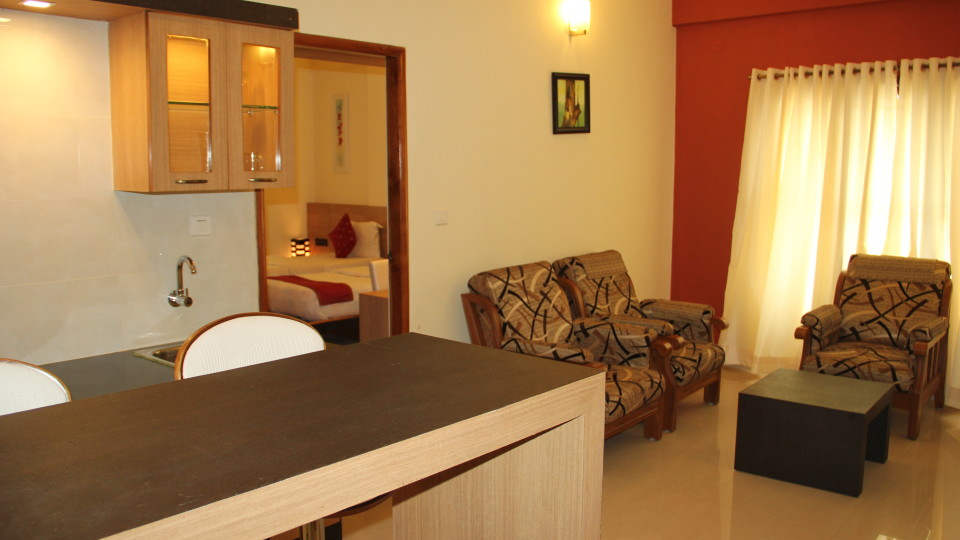 Hotel Arama Suites Bangalore living   bedroom aura suite 2 hotel arama suites bangalore