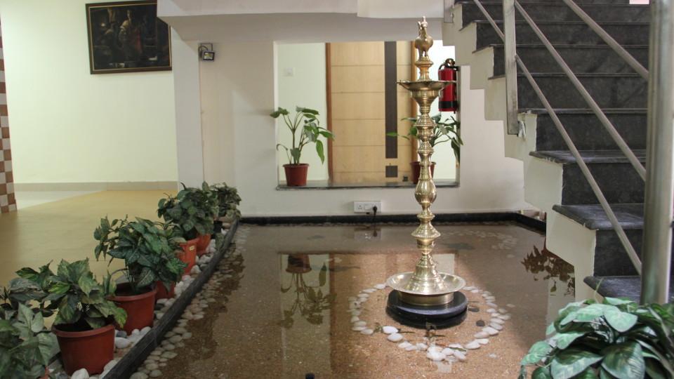 Hotel Arama Suites Bangalore lobby fish pond hotel arama suites bangalore