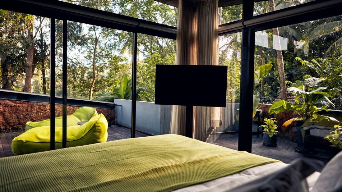 Bedroom with glass windows at one of the best villas in North Goa - Villa in Palms by V Escapes