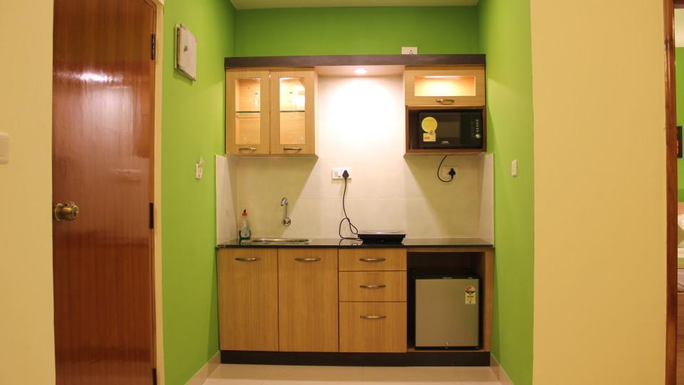 Hotel Arama Suites Bangalore kitchenette 1 aura suite  hotel arama suites bangalore