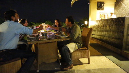 The deck - grill n barbecue at The golden tusk resort, restaurant near Corbett National Park 1