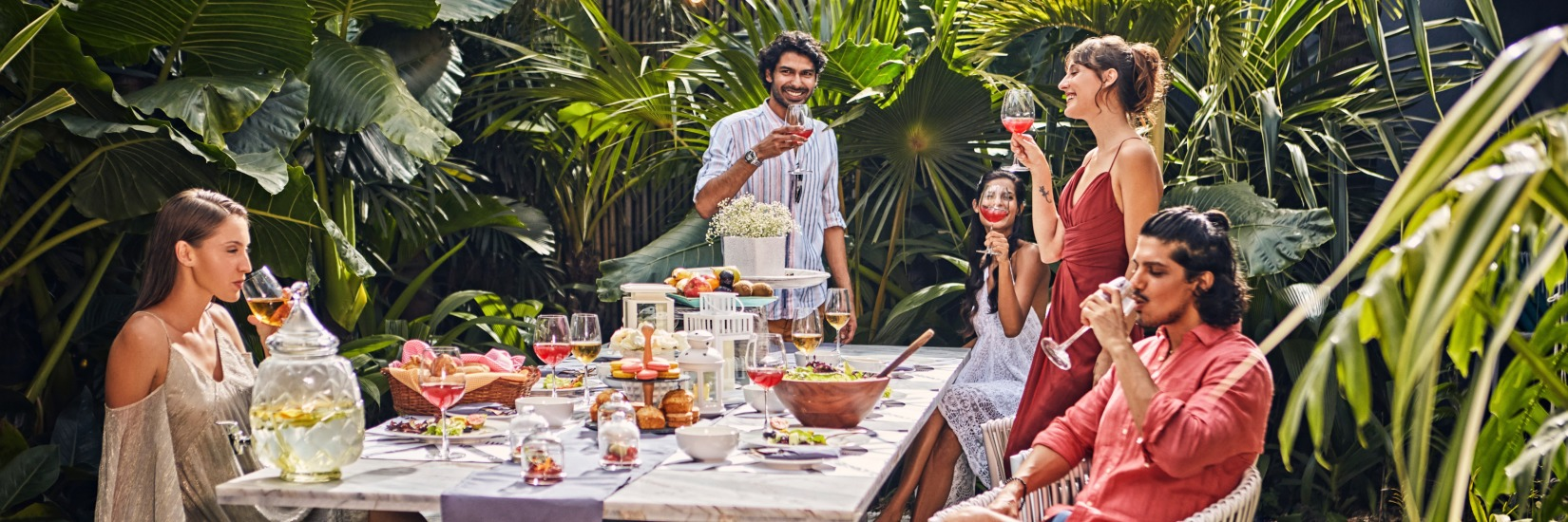 Guests drinking and eating at the luxury villa with chef in Goa - Villa in Palms by V Escapes