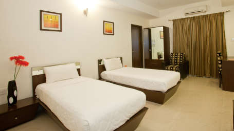 Serenity Inn  Club Room Hotel Niche Suites by Serenity Domlur Bangalore 1