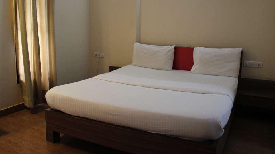 Hotel Arama Suites Bangalore aqua suite bedroom 1 hotel arama suites bangalore