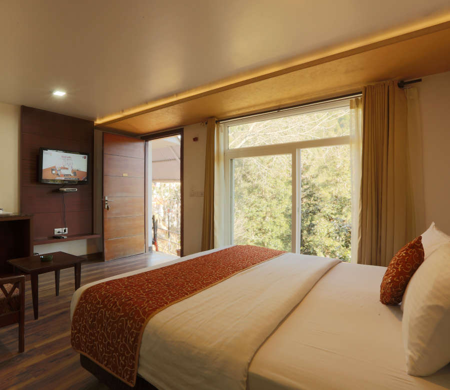 alt-text Deluxe Room with garden view at Alps Resort Dalhousie 1