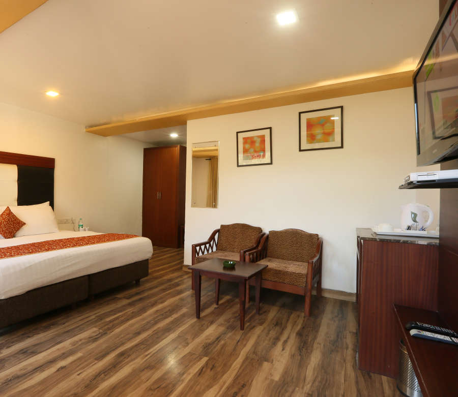 alt-text Deluxe Room with garden view at Alps Resort Dalhousie 9