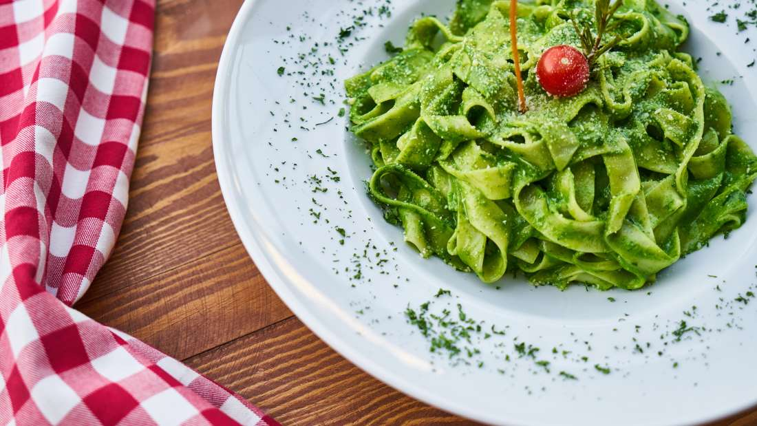 Canva - Flat Pasta Noodle With Green Sauce Dish and Cherry Tomato on Top