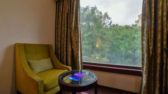 Living area at Hotel Mint Oodles, Hotel rooms in Nehru Place, Stay in Nehru Place