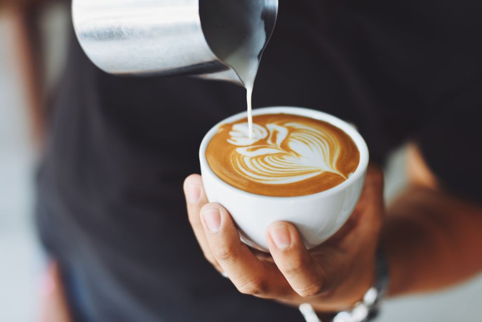 Canva - Person Performing Coffee Art