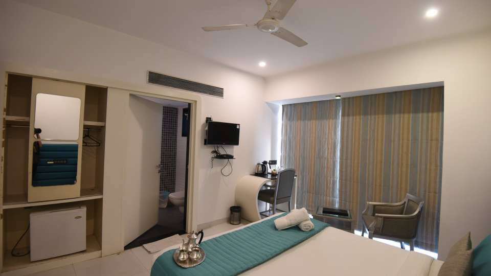 Deluxe Room at VITS Sharanam Hotel Best Hotels in Thane near Eastern Express Highway 7