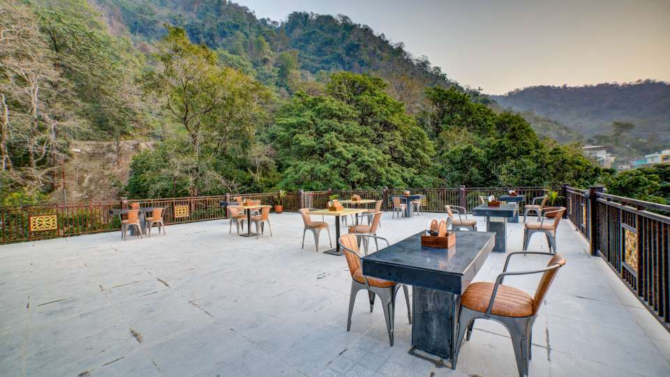 Terrace overlooking the hills at The Hideaway Bedzzz Rishikesh