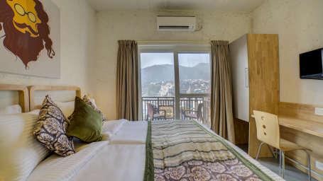 Deluxe room overlooking Ganges at The Hideaway Bedzzz Rishikesh