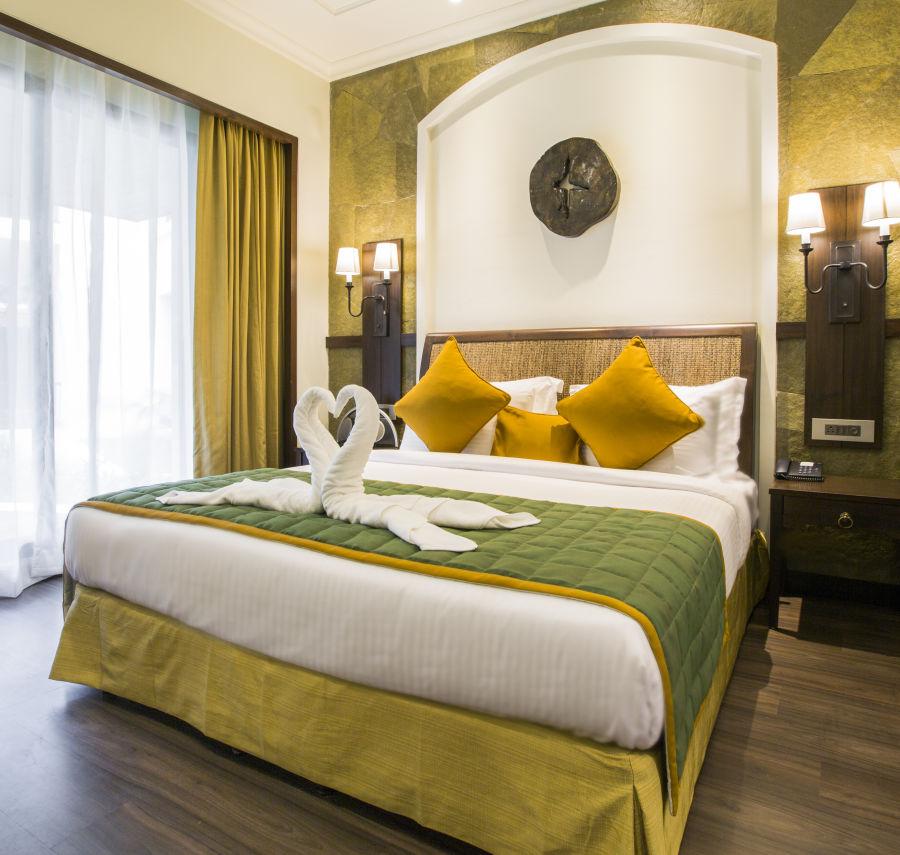 alt-text 5 star resorts in Lonavala - 6 Banyan Family Suite - Bedroom