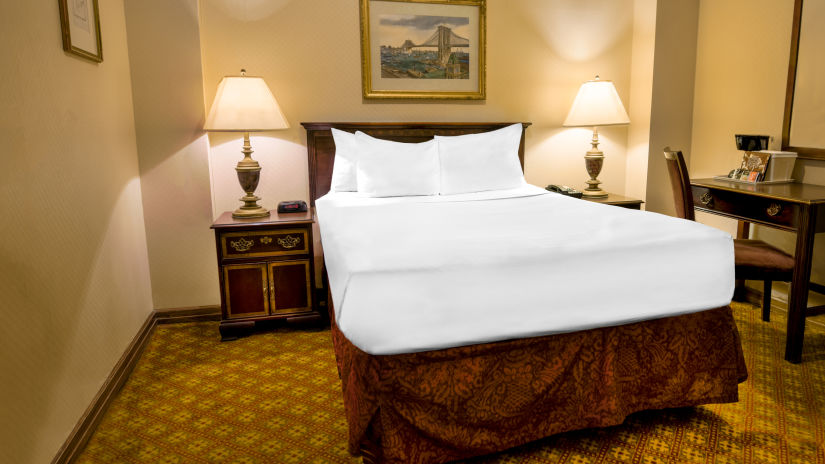 Comfortable beds within the Standard Full Bedroom at Night Hotel Broadway