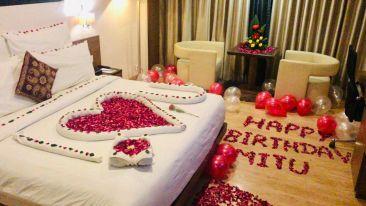 birthday decoration in the room at Narayani Heights, hotel room in Gandhinagar