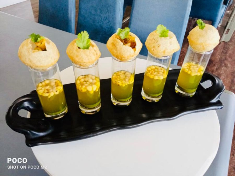 alt-text pani puri served at the restaurant at Narayani Heights, restaurant in ahmedabad 7