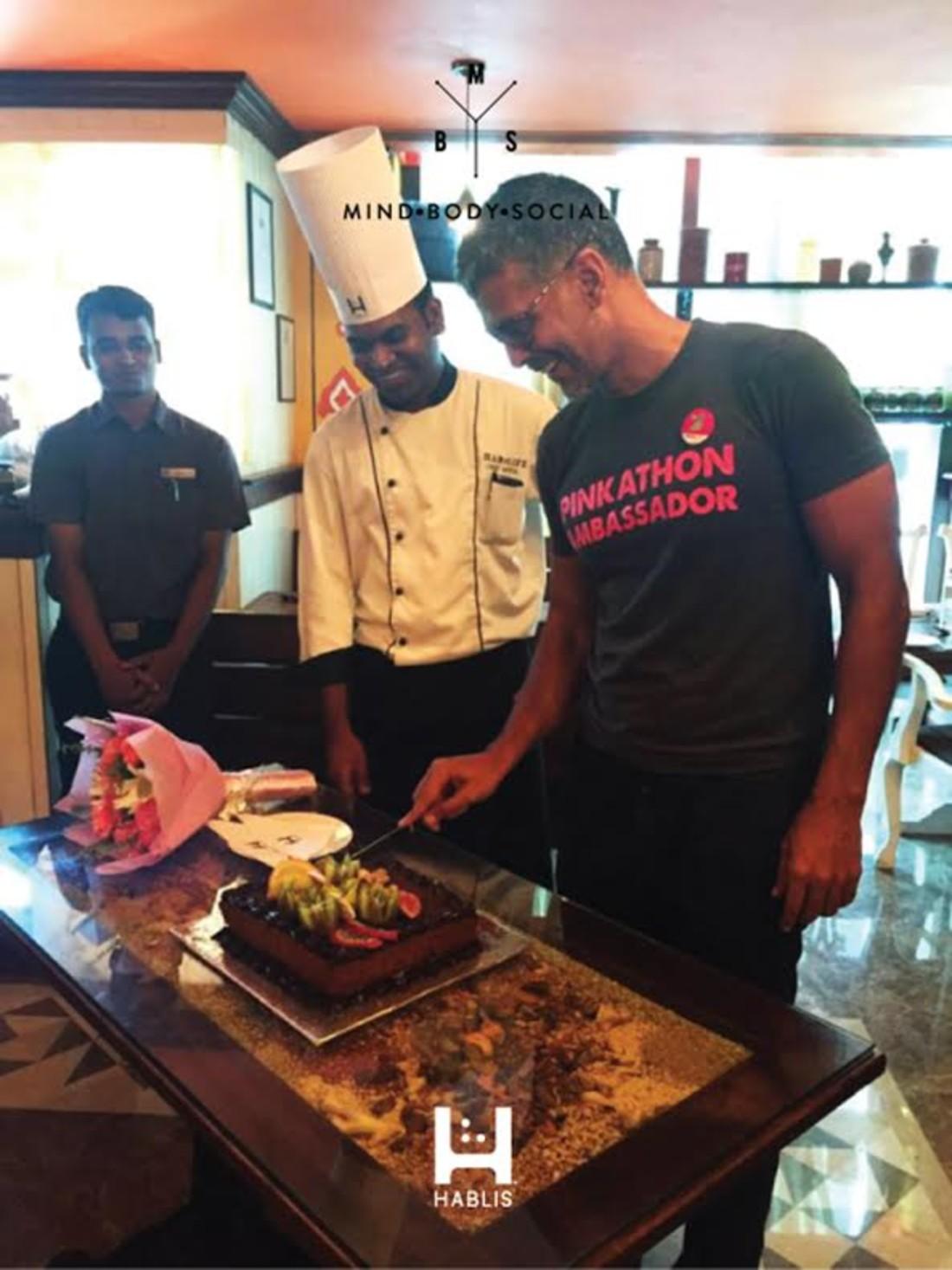 Hablis Hotel Chennai Chennai milind-soman-cutting-jaggery-cake-by-chef-sathya-at-hablis