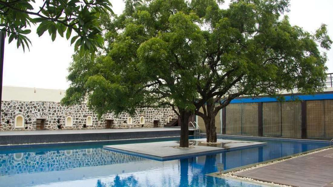 swimming pool at fort jadhavgadh heritage hotel pune - resort near mumbai