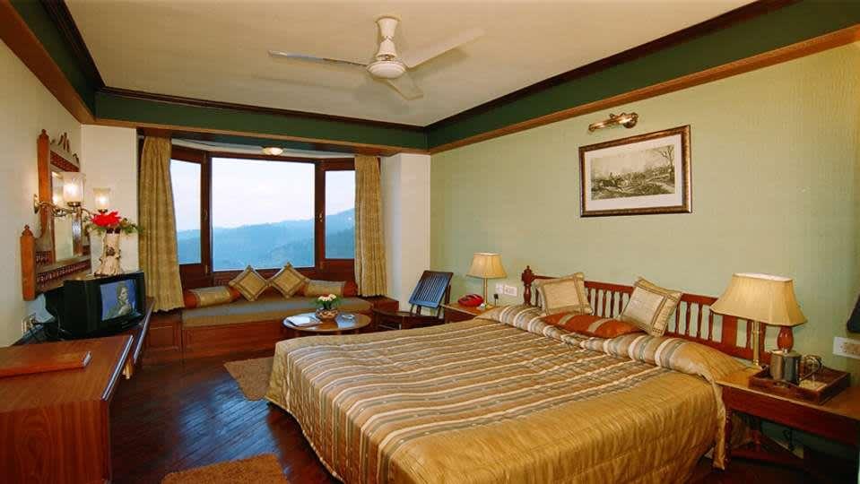 Sun n Snow Inn Hotel Kausani Kausani Suite Room Sun n Snow, hotels in kausani, Uttarakhand hotels, kausani hotels
