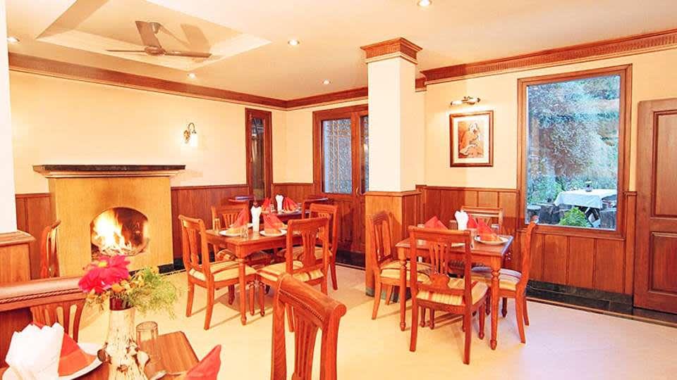 Sun n Snow Inn Hotel Kausani Kausani Restaurant Sun n Snow Inn, hotels in kausani, Uttarakhand hotels, kausani hotels
