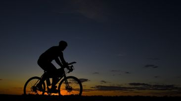 man-riding-bicycle-during-nightfall-207779