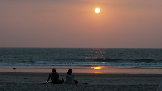 Couple sitting by the beach, Honeymoon Special Volvo Package, AMARA GRAND INN CALANGUTE