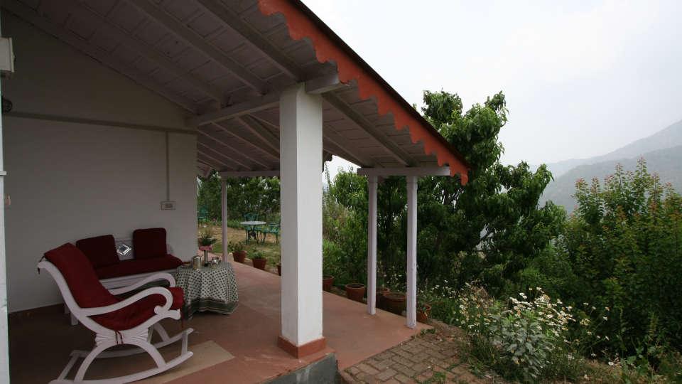 The Ramgarh Bungalows - 19th C, Kumaon Hills Kumaon Rocking chair at Vista Villa to admire the Himalayas