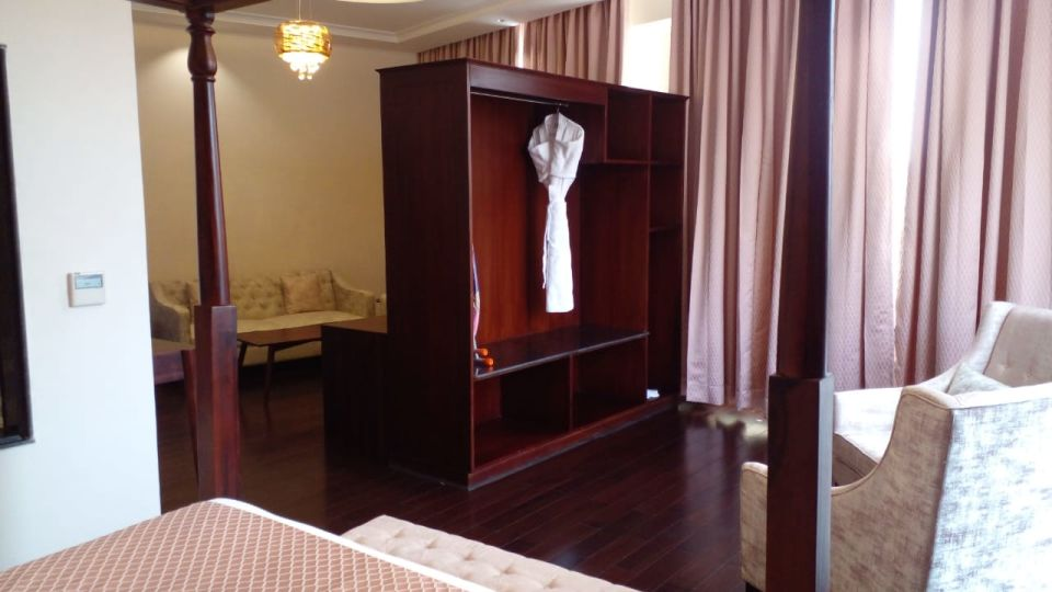 Four poster bed and wardrobe at our Luxury  hotel in Shimla