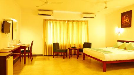 Renai Green Fields Kumarakom Resort Deluxe Room with King Size Bed