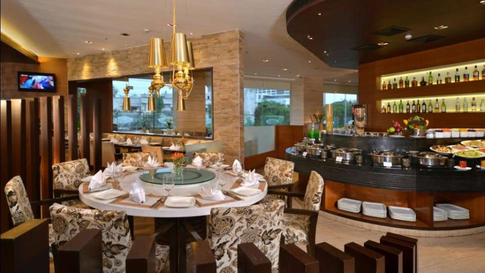 White Violet Restaurant at HotelMajestic Court Sarovar Portico Navi Mumbai 5