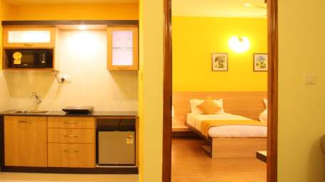Hotel Arama Suites Bangalore kitchene bedroom hotel arama suites bangalore