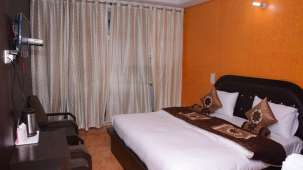 Deluxe Bed, Hotel Trishul, Hotels in Haridwar2