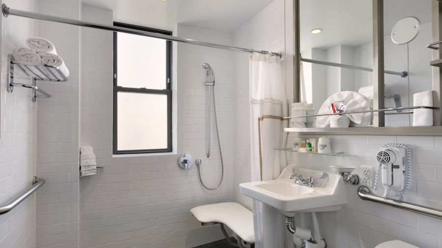 alt-text Standard Guest Bathroom at Night Hotel Broadway