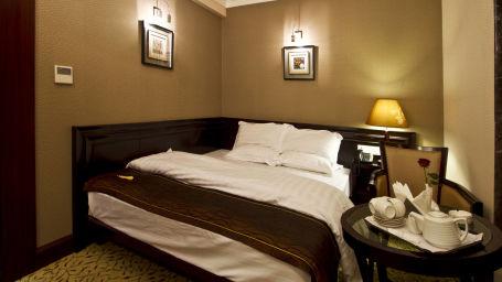 King size bed in Premium Deluxe rooms in Patna
