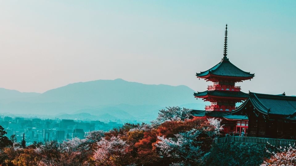 red-and-black-temple-surrounded-by-trees-photo-402028