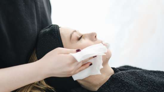 photo-of-person-using-a-tissue-to-dry-a-woman-s-face-3738344