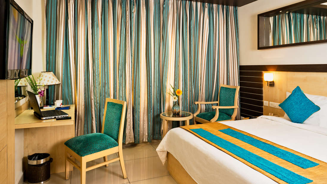 Deluxe Rooms1_hotel rooms in Vijayawada_Hotel Southern Grand