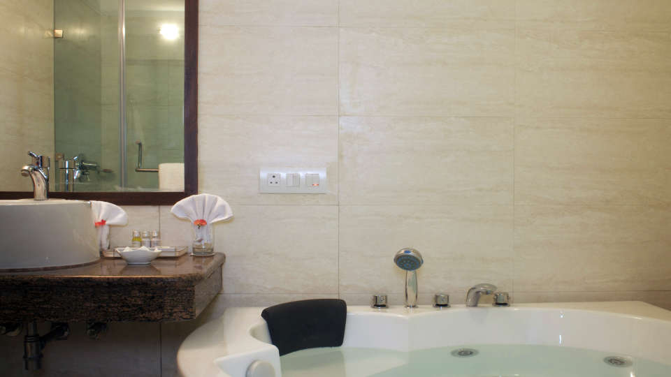Bathroom at Legend Sarovar Portico, Baddi