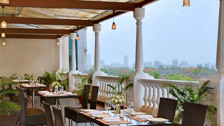 White Violet Restaurant at Hotel Majestic Court Sarovar Portico Navi Mumbai 1