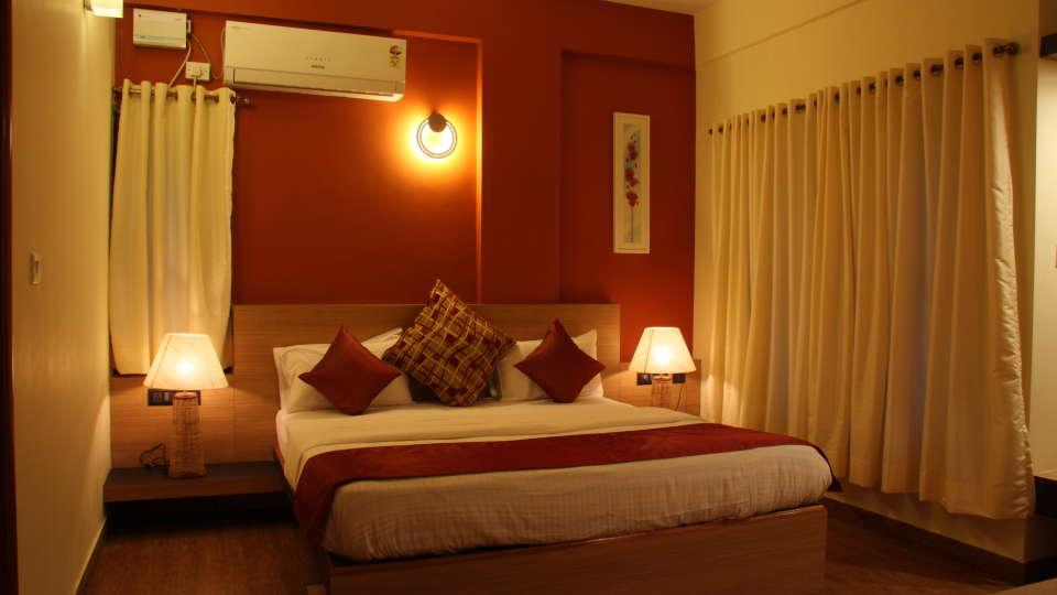 Hotel Arama Suites Bangalore bedroom aura suite 5 hotel arama suites bangalore
