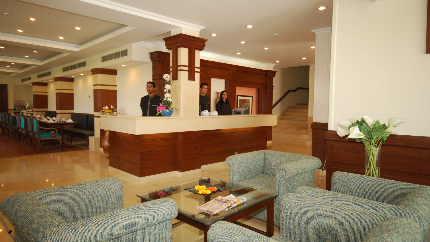 Lobby with sofas and a table at our hotel in Mussoorie, Hotel Madhuban Sarovar Portico, Mussoorie
