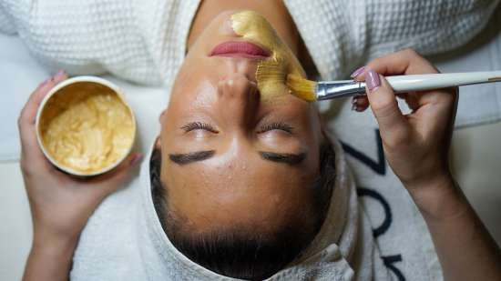 woman-doing-facial-mask-3212179
