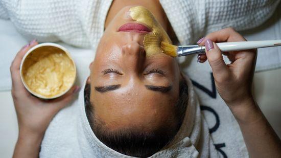 woman-doing-facial-mask-3212179