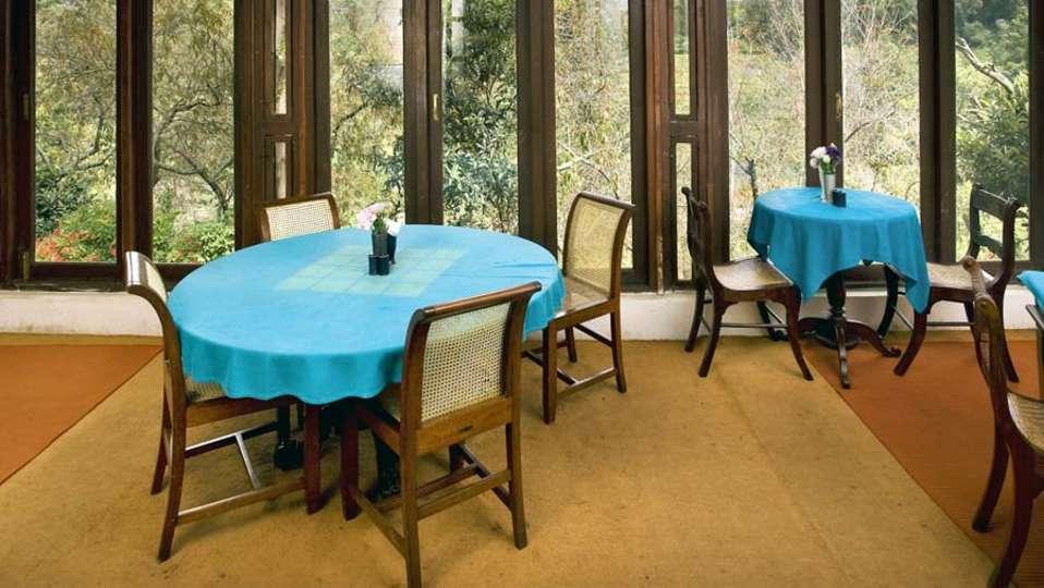 Wallwood Garden - 19th C, Coonoor  The restaurant with views of greenery outside Wallwood Garden Coonooor Tamil Nadu