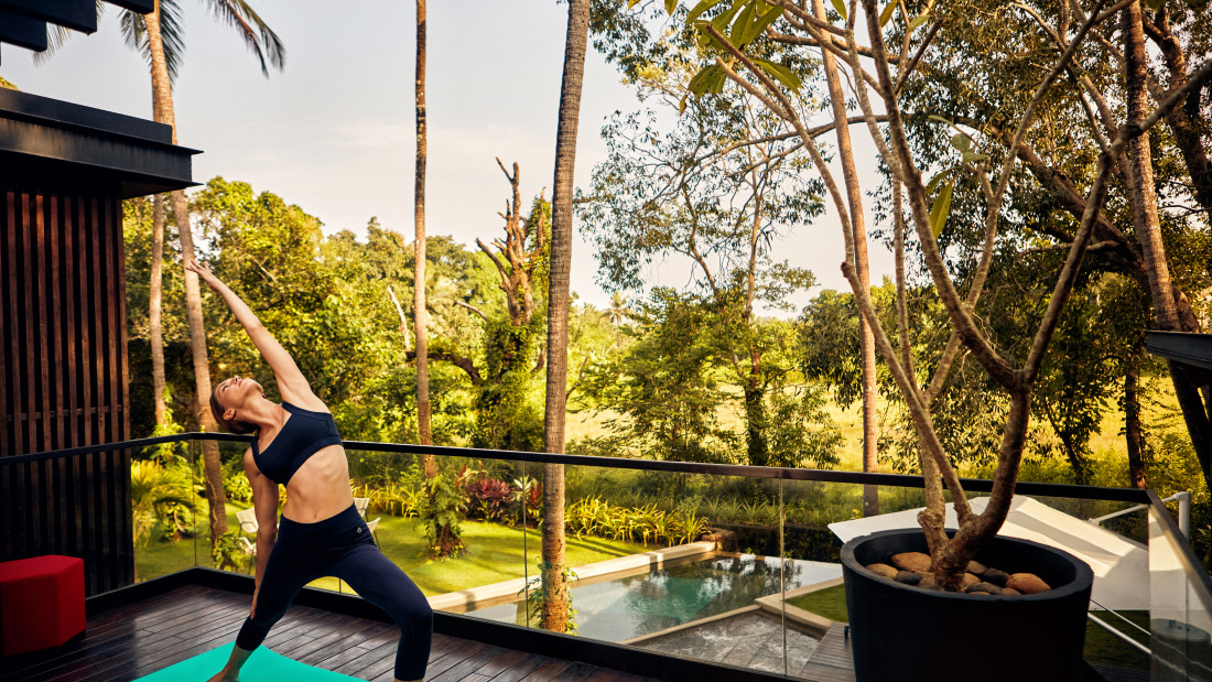 Woman doing yoga and relaxing at the villa in Calangute - Villa in Palms by V Escapes