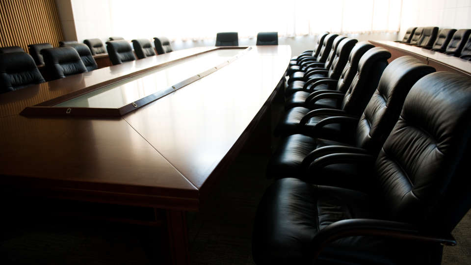 Empty-boardroom-desk