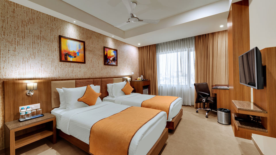 Deluxe Twin Bed at Anaya Beacon Hotel in Jamnagar 2