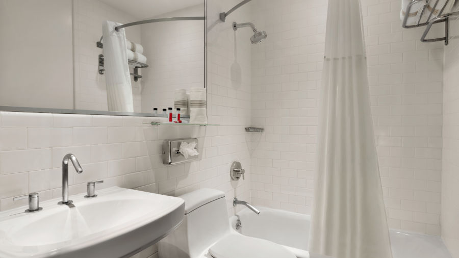 alt-text A private guest bathroom within the Standard Rooms at Night Hotel Broadway